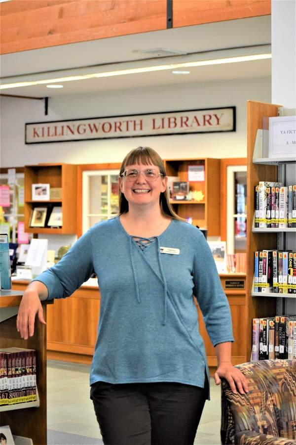 Assistant Director Tammy Eustis has been working at the Killingworth Library since 1998, improving services and making sure patrons receive their reference needs.  Photo by Maria Caulfield/The Source