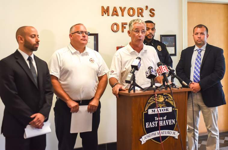 East Haven Mayor Joseph Maturo, Jr. (at podium) gave the first details about the 14 year-old boy who was shot in an attempted robbery in East Haven on Aug. 22.  Joining him for the press conference were (from left) State Representative and Town Attorney Joe Zullo, Fire Chief Matt Marcarelli, Police Department Lieutenant Joseph Murgo, and Police Chief Ed Lennon. Photo by Kelley Fryer/The Courier