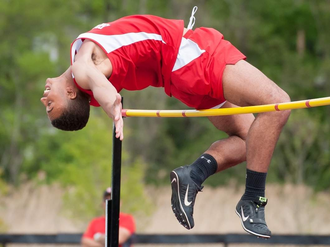 Branford's Brandon Perez cleared a height of 6 feet to take first place in the high jump at the SCC West Sectional Championship in May 2018, and Shore Publishing Chief of Photography Kelley Fryer was right there to capture the action. Photographers like Fryer always have to stay one step ahead of the game to make sure they are in the right place at the right time to get the best shot. File photo by Kelley Fryer/Shore Publishing
