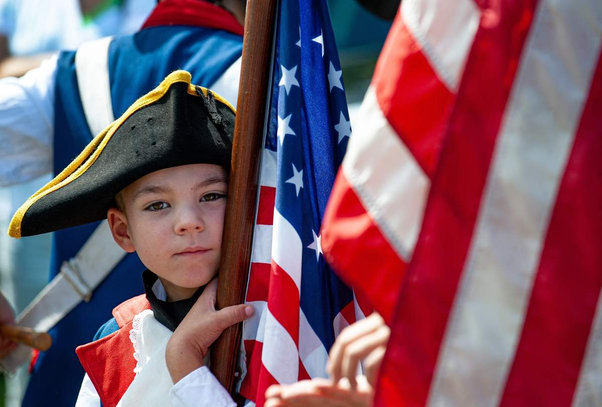 Westbrook held its 60th Annual Drum Corps Muster and Tattoo August 23rd and 24th.  Over 40 fife and drum corps participated in the parade down Main Street.  Ian Thatch, 6 a colorguard with the Nutmeg Fife & Drum.    Photo by Susan Lambert/Harbor News