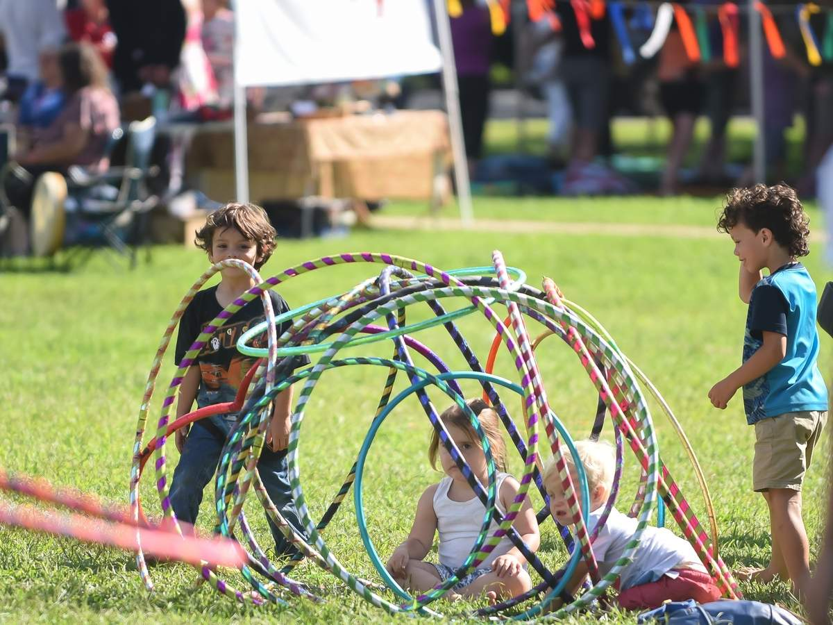 The 3rd annual Oh-Ya Yoga and Arts Fest was held on the Branford Green with Free Yoga, workshops, musci and art for all ages. Leo and Massimo Cherubino stand on the outside of the hula hoop structure which Giovanna Varrone and Timothy Ulmer sit in. Photo by Kelley Fryer/The Sound