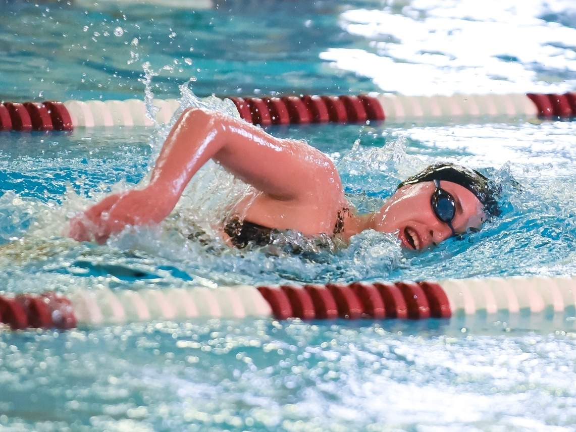 Madeline Bergin and the North Haven girls' swimming diving team are on the road to face Sacred Heart Academy at Albertus Magnus College in their season opener. File photo by Kelley Fryer/The Courier