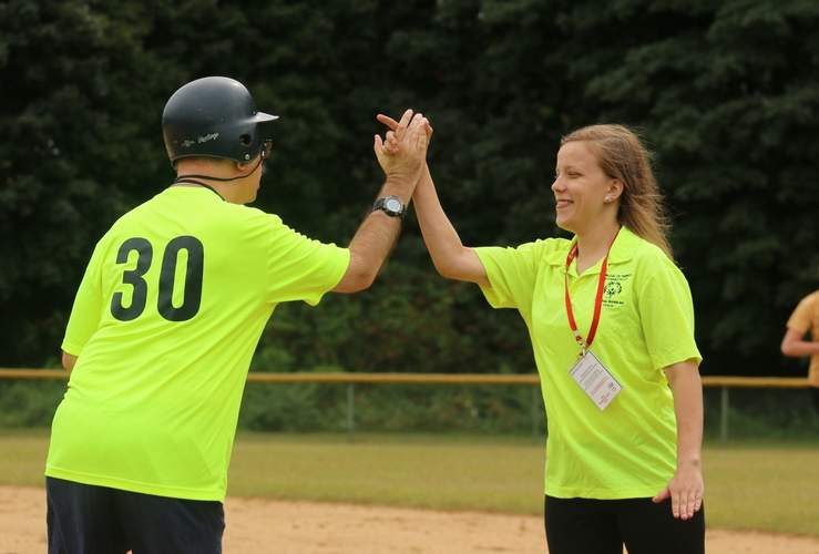 Branford resident Elyssa Whiteman (right), a coach for the Special Olympics Central Shoreline softball squad, congratulates one of her team's athletes on a job well done. Photo by Denise Ciccarelli