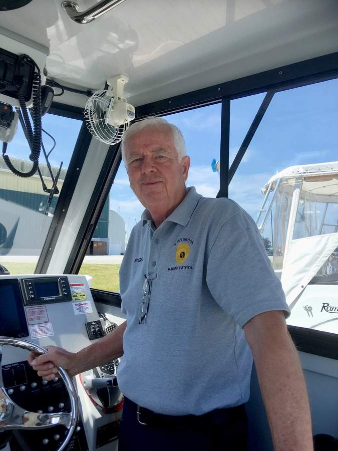 Throughout his career as a teacher and administrator in local schools, Dave Russell has kept his oar in the water as a member of the Westbrook Marine Patrol.   Photo by Aviva Luria/The Courier