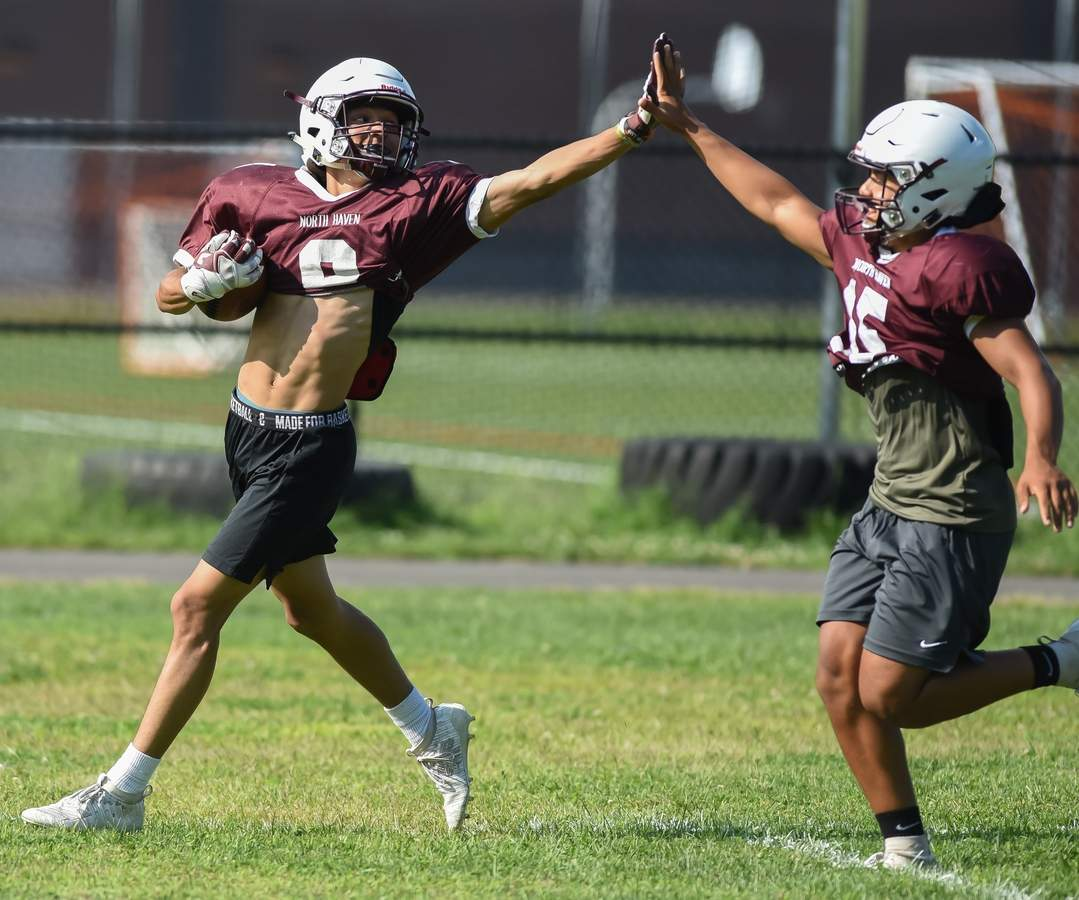 Jaden Watson (8) and Maximino Augustine (15) Photo by Kelley Fryer/The Courier