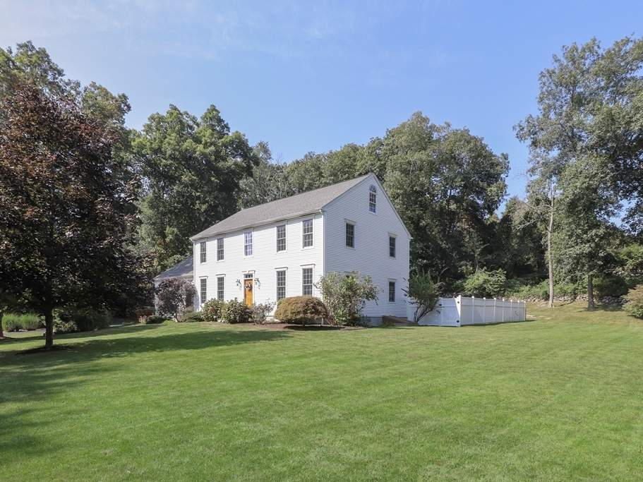 This one-owner Colonial occupies a corner lot on a quiet cul de sac.