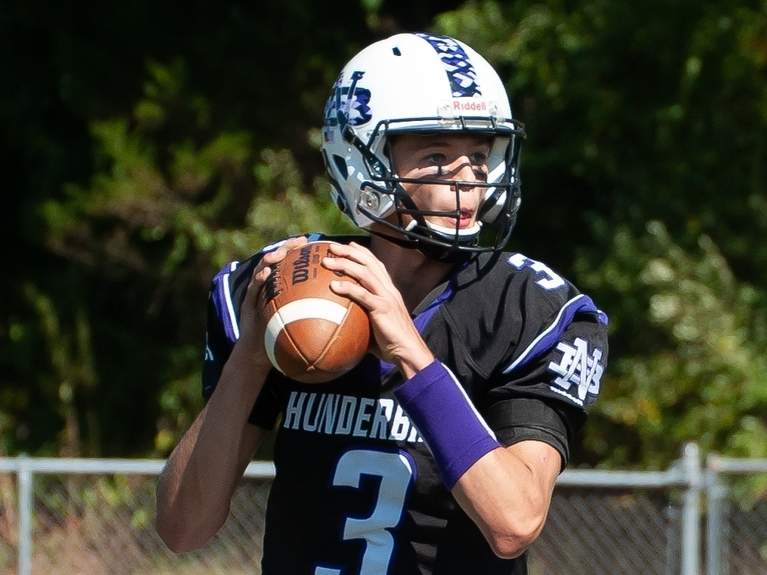 Junior quarterback Brandon Fratta threw for 404 yards and five touchdowns to lead the Thunderbirds to their blowout victory over Old Saybrook-Westbrook on Oct. 19. File photo by Kelley Fryer/The Sound
