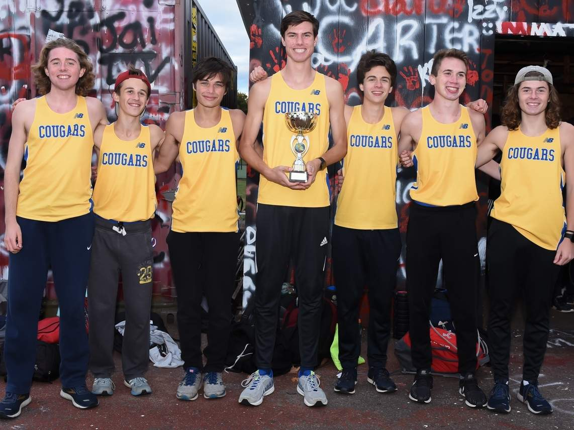 The Haddam-Killingworth boys' cross country team captured the Shoreline Conference title for the sixth year in a row by taking first place at the league meet in Cromwell. Pictured from the Cougars are Fisher Harris, Julian Spector, Caleb Freeman, Matt Jennings, Christian Uzwiak, Griffin Robinson, and Sean Rutledge. Photo by Kelley Fryer/The Source