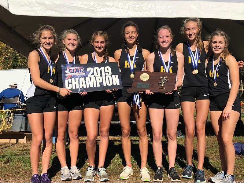 The Haddam-Killingworth girls' cross country squad claimed its third state crown in five years by taking first place at the Class SS State Championship at Wickham Park on Oct. 26. Pictured from the team are Isabel Berardino, Brianna Minervino, Ava DiMatteo, Julia Callis, Lauren D'Amico, Meara Bodak, and Ali Twachtman. Photo courtesy of Matt Diglio