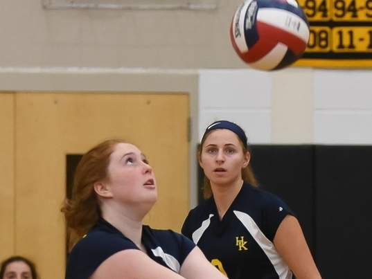 Lizzy Celano and the Haddam-Killingworth girls' volleyball team are playing in states this week after opening the postseason by competing in Shorelines last week. Pictured in the background is Jessica Timothy. File photo by Kelley Fryer/The Source