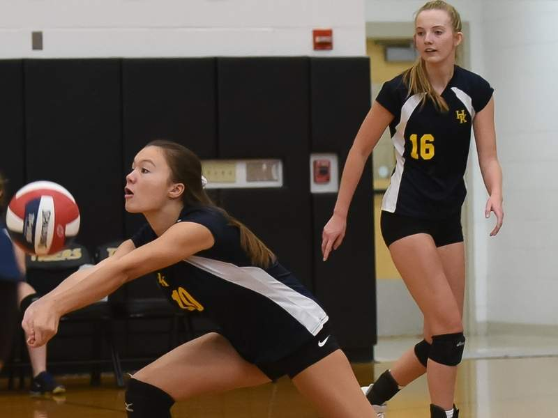 Lola Chagnon, Teagan Chrzanowski, and the H-K girls' volleyball team reached the Class M state semifinals after notching victories in their first three matchups of the draw. File photo by Kelley Fryer/The Source