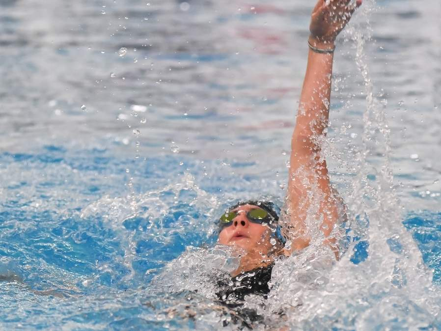 Senior Kayla Mendonca claimed first place in the 100 backstroke to lead the Hand girls' swimming and diving team to a second-place finish at the Class M State Championship. Mendonca also swam on the Tigers' victorious 400 freestyle relay at the meet. File photo by Kelley Fryer/The Source