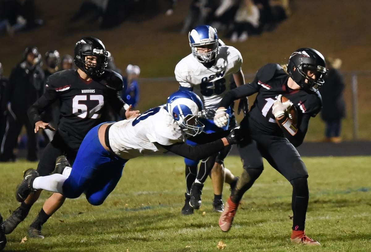 Valley Regional - Old Lyme beat Old Saybrook - Westbrook football 35-12 at  home. Jeremy Rand  (62),  James Marsden (19) Photo by Kelley Fryer/The Courier