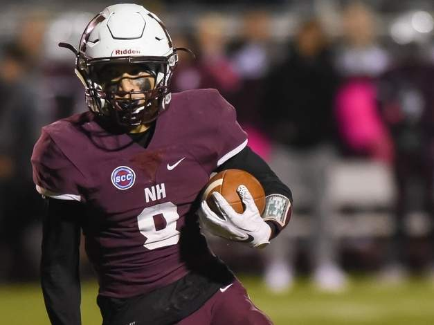 Senior Jaden Watson rushed for 210 yards and three touchdowns to lead the North Haven football team to a 49-13 win at Amity on Thanksgiving Eve. File photo by Kelley Fryer/The Courier