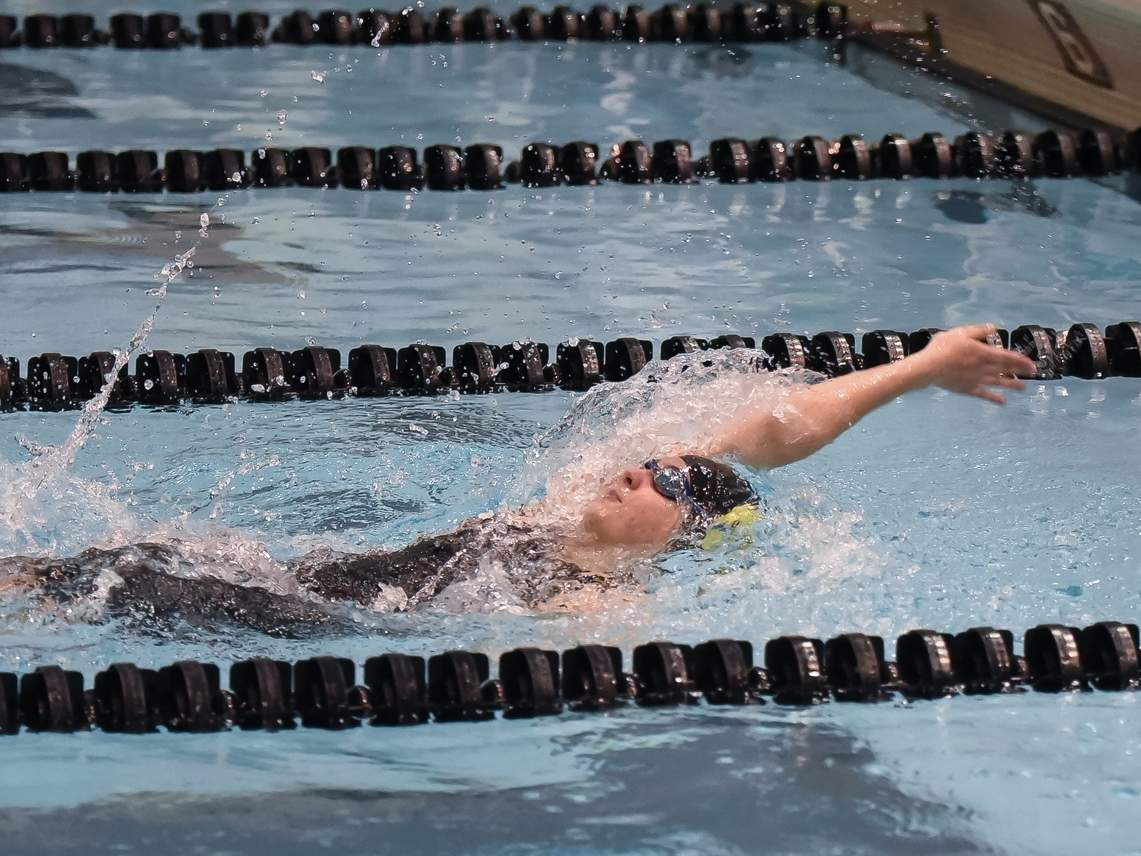 Kayla Mendonca finished sixth in the 100 backstroke and came in 13th place for the 100 butterfly to lead the Hand girls' swimming and diving squad to a 17th-place performance at the State Open Championship at Yale University. File photo by Kelley Fryer/The Source