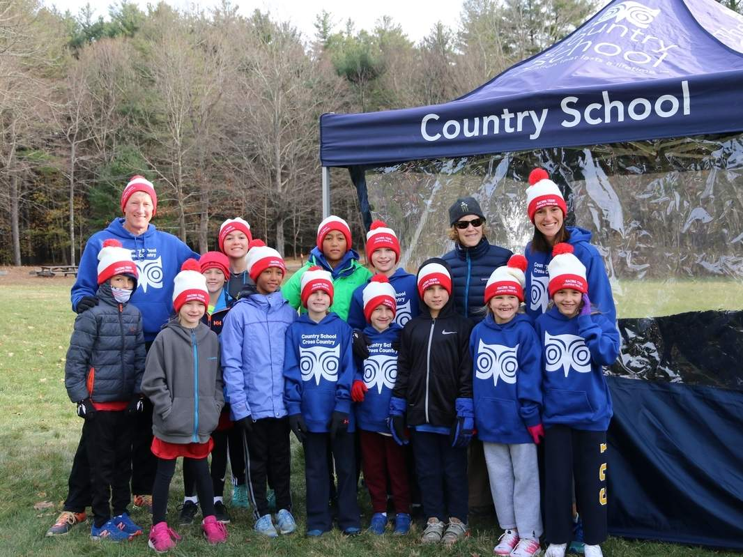 The Country School was well represented at the Region 1 Junior Olympics Cross Country Championships. Pictured are (front) Keve Frusztajer (Guilford), Quinn Freeman (Guilford), Sam Duffy (Madison), Lalia Goodman (Old Lyme), Lillian Clare (Madison), Tash Frusztajer (Guilford), Kieran Freeman (Guilford), Liv Killam (Madison), and Tillie Killam (Madison); along with (back) coach John Fixx, Anna Vlieks (Madison), Gabe Goodman (Old Lyme), Miklosh Frusztajer (Guilford), coach Beth Coyne, and coach Blair Lachance. Photo courtesy of The Country School