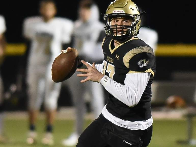 Senior captain quarterback Phoenix Billings broke a school record with six touchdown passes when the Hand football squad routed Newington by a 52-0 score in a Class L State Playoffs quarterfinal game at the Surf Club on Dec. 3. Visit Zip06.com to see more photos from this game. Photo by Kelley Fryer/The Source