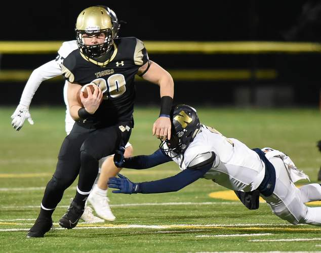 Senior Colin McCabe and the Hand football team advanced to face Maloney in the Class L semifinals following a lopsided win against Newington in the quarterfinal round. Photo by Kelley Fryer/The Source