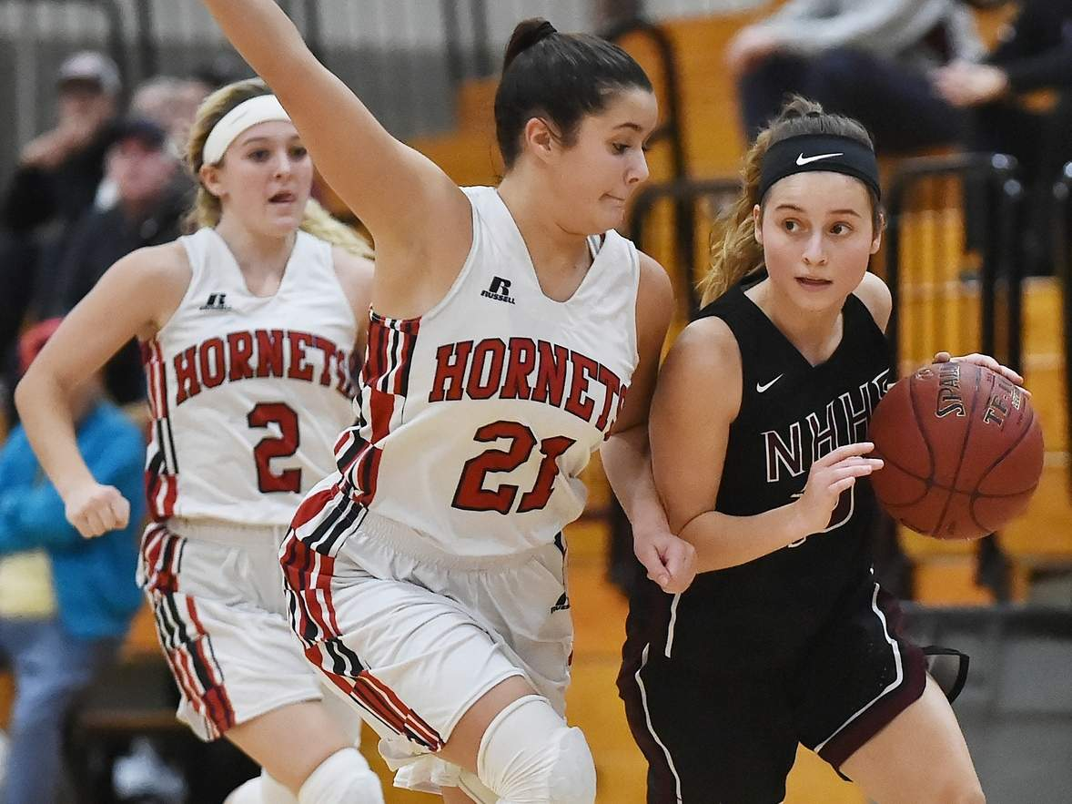 Senior captain shooting guard Laura Petrafesa (right) and the North Haven girls' basketball team are looking for a return trip to the Class L State Tournament in their first season with Head Coach Tom Blake. File photo by Catherine Avalone/The Courier