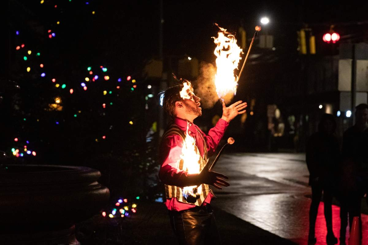 The rainy weather didnþÄôt stop the festivities at the annual Holiday Stroll and Light Parade in downtown Deep River on Saturday, December 14, 2019. There was a tree lighting, parade, caroling, free cookies and hot chocolate, open shops and restaurants with specials and treats, fire performers, a find the Holiday Moose Contest, and a meet and greet with Santa. The event was hosted by the Deep River Parks and Recreation Department. JumpinþÄô Joe (Deep River Fire Spinners) performs for those who stop by to watch. Photo by Meglin Bodner/The Courier