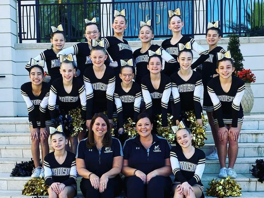 The Madison Youth Cheer competition squad took second place at the National Championships in Florida. Pictured are (back) Juliana Jorens, Allison Mulhern, Sophie Elder, Mia Scott, Lucy Cummings, and Julianna Picard; (middle) Gianna Foligno, Katelyn Zagami, Lilyana Signore, Ashley Fiorella, Hailey Yahara, Cristina Case, and Abby Kustra; (front) Alessandra Picard, Coach Michelle O'Dea, Coach Lindsay Smith, and Neala O'Dea. Photo courtesy of Michelle O'Dea