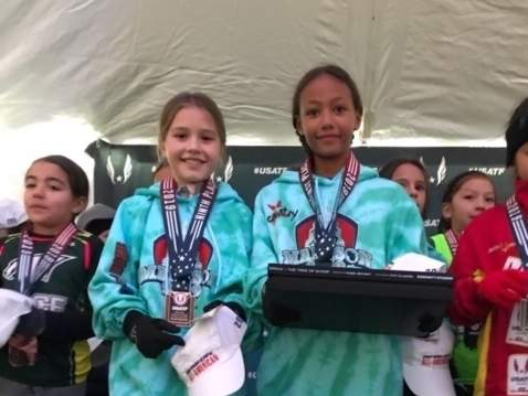 Tillie Killam of Madison and Laila Goodman of Old Lyme receive their All-American awards for finishing in ninth and first place, respectively, at the National Junior Olympics in Madison, Wisconsin. Photo courtesy of The Country School