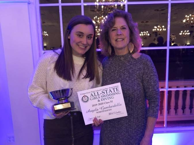 North Haven senior Angela Gambardella was selected as the MVP of the Class M Girls' Swimming and Diving State Championship after winning the 200 individual medley and the 100 breaststroke with meet-record times. Pictured are Gambardella and Indians' Head Coach Martha Phelan at the All-State Banquet on Dec. 18. Photo courtesy of Ellen Bergin