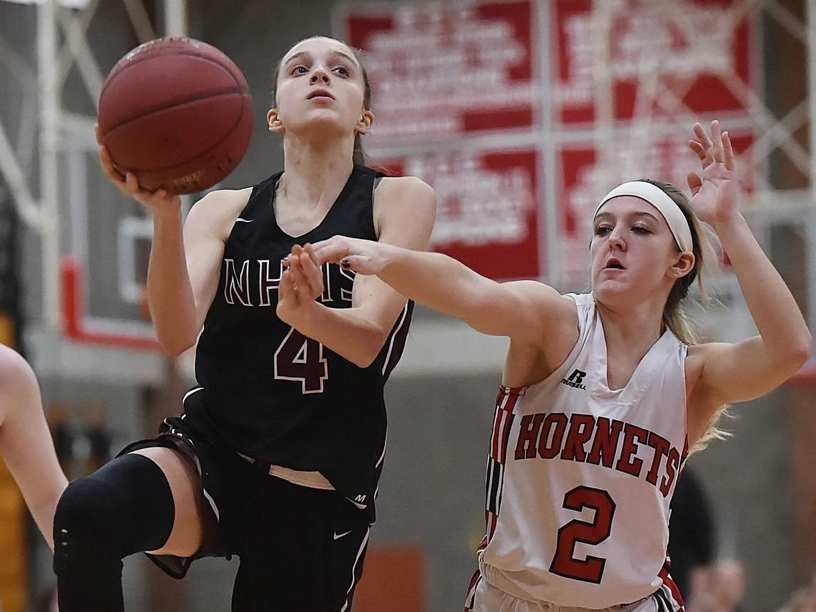 Junior Sarah Puzone (left) and the North Haven girls' basketball squad started off their campaign with a convincing win against Stratford last week. File photo by Catherine Avalone/The Courier