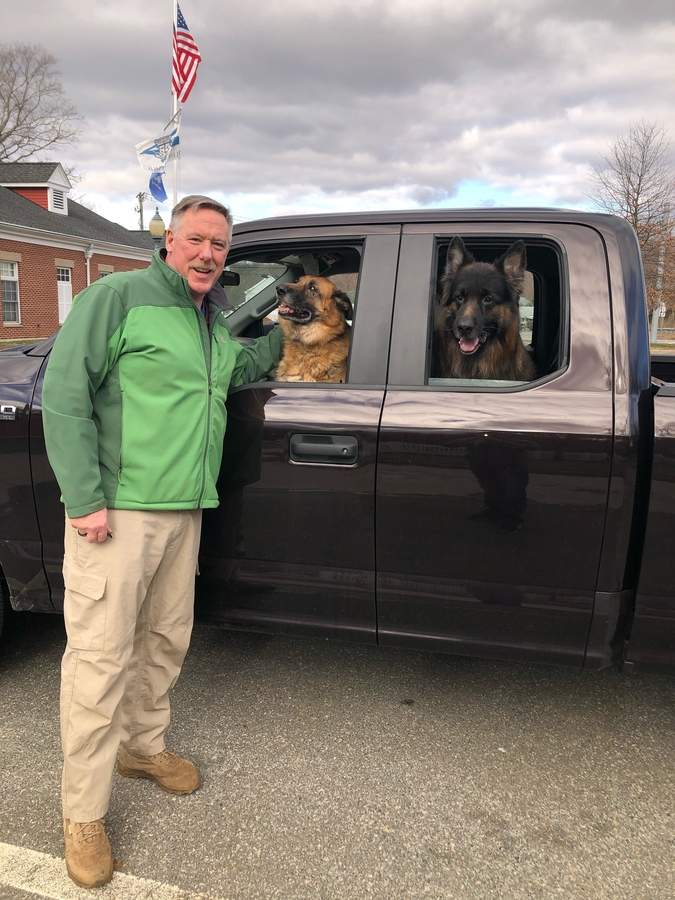 After more than two decades of serving in Clinton as a police officer (among other roles) Jerry Dunn (shown here with Boston and Amigo) is retiring from the department to take a job with the state Department of Agriculture Animal Control Unit.  Photo by Eric O'Connell/Harbor News