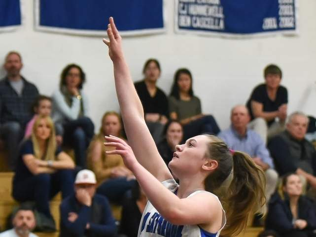 Senior Taylor Cote and the Old Saybrook girls' basketball team recorded 42-35 home win against Westbrook on Jan. 7. Cote had a double-double with 10 points and 10 rebounds to her credit. File photo by Kelley Fryer/Harbor News