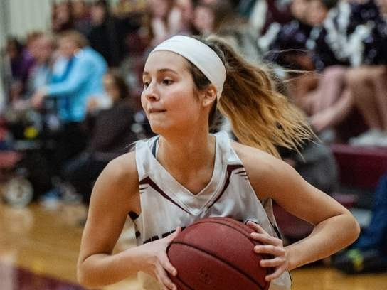 Senior Laura Petrafesa turned in a pair of double-digit scoring performances to help North Haven girls' hoops earn wins versus West Haven and Lauralton Hall last week. Photo by Kelley Fryer/The Courier