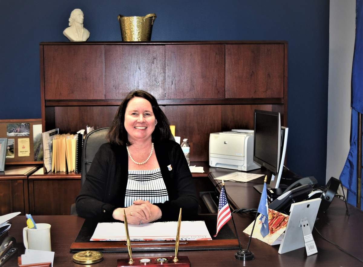 Peggy Lyons combines her knowledge in the financial and investment banking industry, her volunteer experience in various town services, and a global perspective to her position as first selectman for the Town of Madison. Photo by Maria Caulfield/The Source