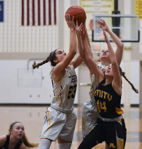 Sophia Coppola scored 11 points when the Hand girls' basketball team defeated Cheshire last week. The Tigers went on to qualify for states with a victory against Hillhouse later in the week. File photo by Kelley Fryer/The Source