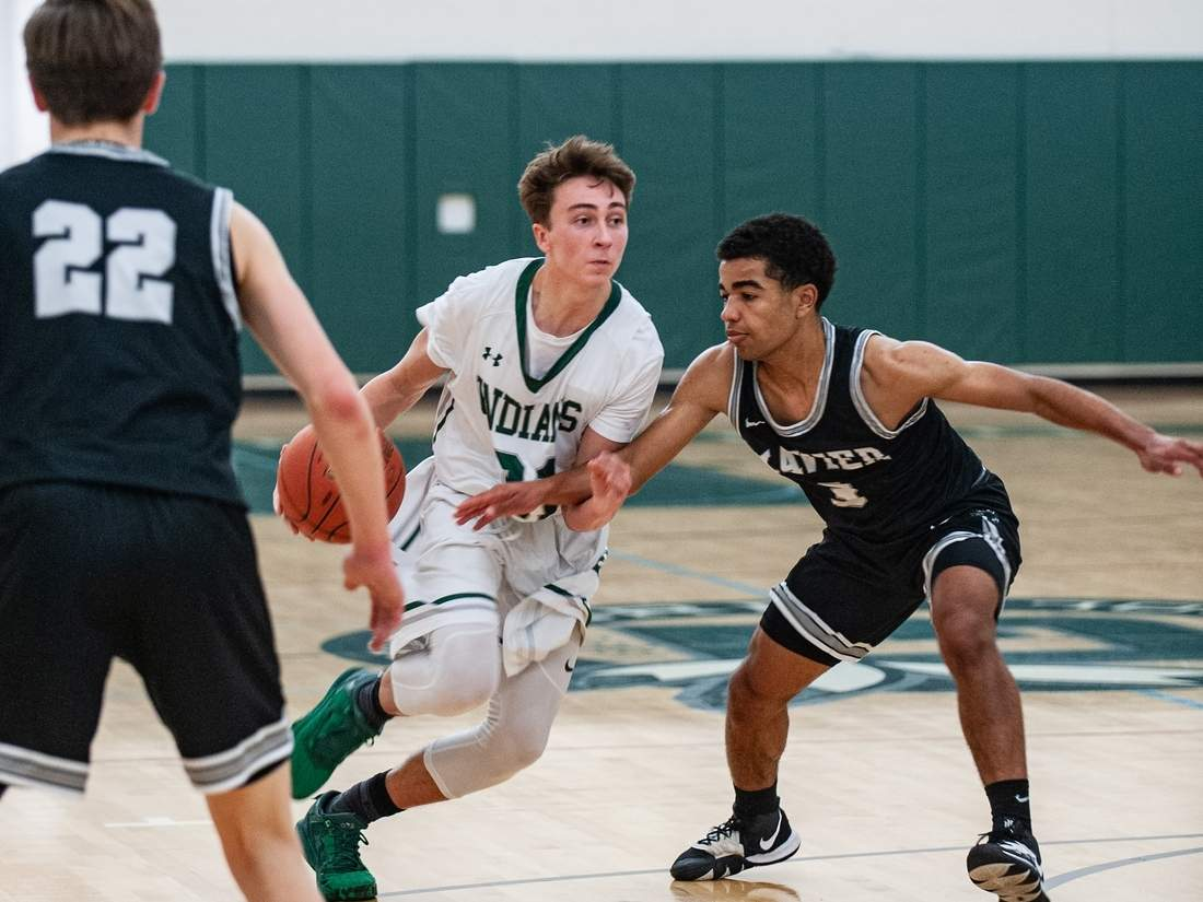 Senior Chris Cahill and the Guilford boys' basketball team won two of three last week to move to 3-6 this year. Cahill poured in 22 points when the Indians defeated Cheshire on Jan. 21. File photo by Susan Lambert/The Courier