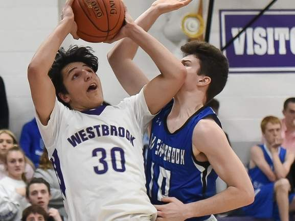 Junior Jack Naccarato and the Westbrook boys' basketball squad lost contests against East Hampton and Morgan last week. Naccarato led all scorers with 25 points in the defeat versus Morgan. Also pictured is Old Saybrook senior Mike Almada  File photo by Kelley Fryer/Harbor News