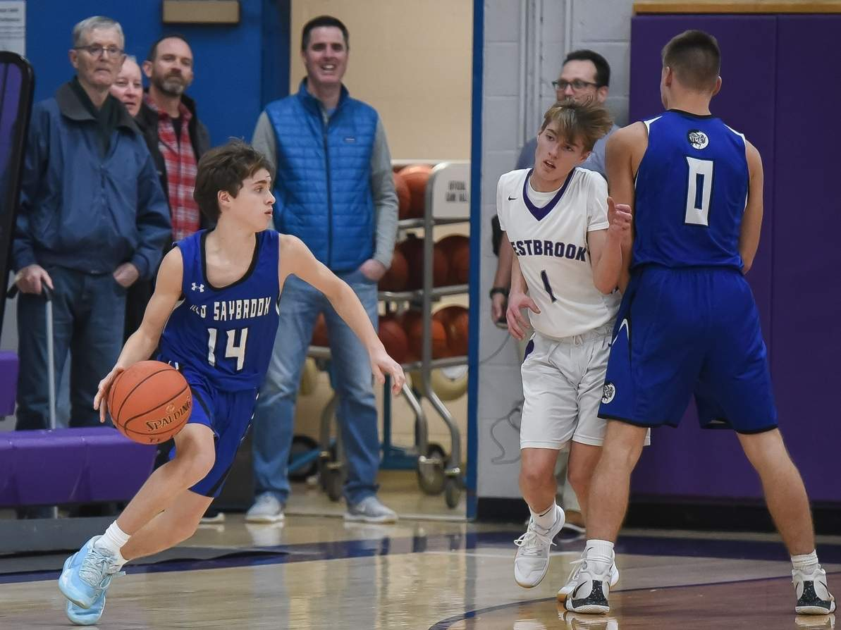 Ryan Stratton (left) and the Old Saybrook boys' basketball team dropped three decisions in as many contests last week. Stratton scored nine points in a Rams' loss versus Haddam-Killingworth on Jan. 20. Also pictured for Old Saybrook is Tucker Gometz. File photo by Kelley Fryer/Harbor News