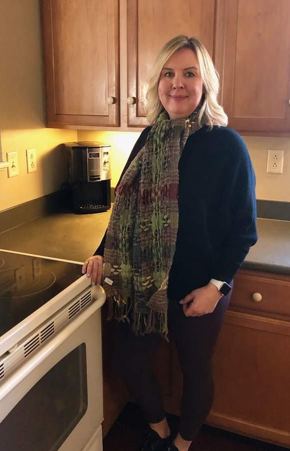 With a clutter-free life the natural result of growing up in a military family, Eva Counter draws on her skills and inclination as professional organizer.   Photo by Rita Christopher/The Courier