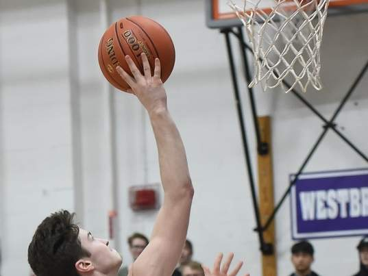Michael Almada and the Old Saybrook boys' basketball team took a pair of narrow defeats last week. Almada scored a total of 36 points between the two losses. File photo by Kelley Fryer/Harbor News