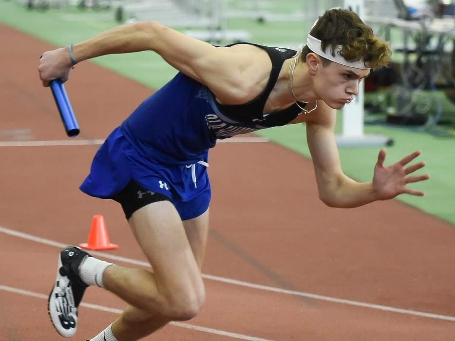 Cooper Luciani and the Old Saybrook boys' track team placed second overall at the Shoreline Conference Championship meet at Floyd Little Athletic Center on Feb. 8. Luciani was part of a first-place finishing 4x800-meter relay squad. Photo by Kelley Fryer/Harbor News