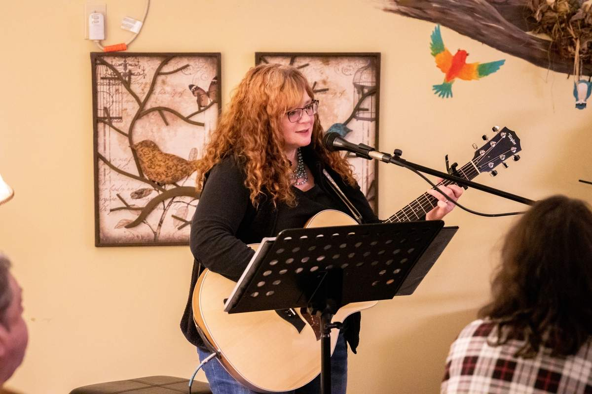 The Nest Coffee House and A Little Compassion Inc. (a nonprofit dedicated to changing the lives of young adults with disabilities) hosted another Open Mic Night on Saturday, February 8, 2020. Singers and poets performed for an audience at The Nest in downtown Deep River. Kat Caron performs the song Budapest by George Ezra. Photo by Meglin Bodner/The Courier