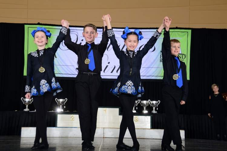 The mixed U-10 four hand team claimed eighth place for the Gray School at the New England Regional Irish Dance Championships. Pictured are Hannah Belknap (Old Saybrook), Ronan Curran (Brooklyn), Keira O'Donnell (Old Saybrook), and Nathan Belknap (Old Saybrook). Photo courtesy of Tom Gregory/Shamrock Photography