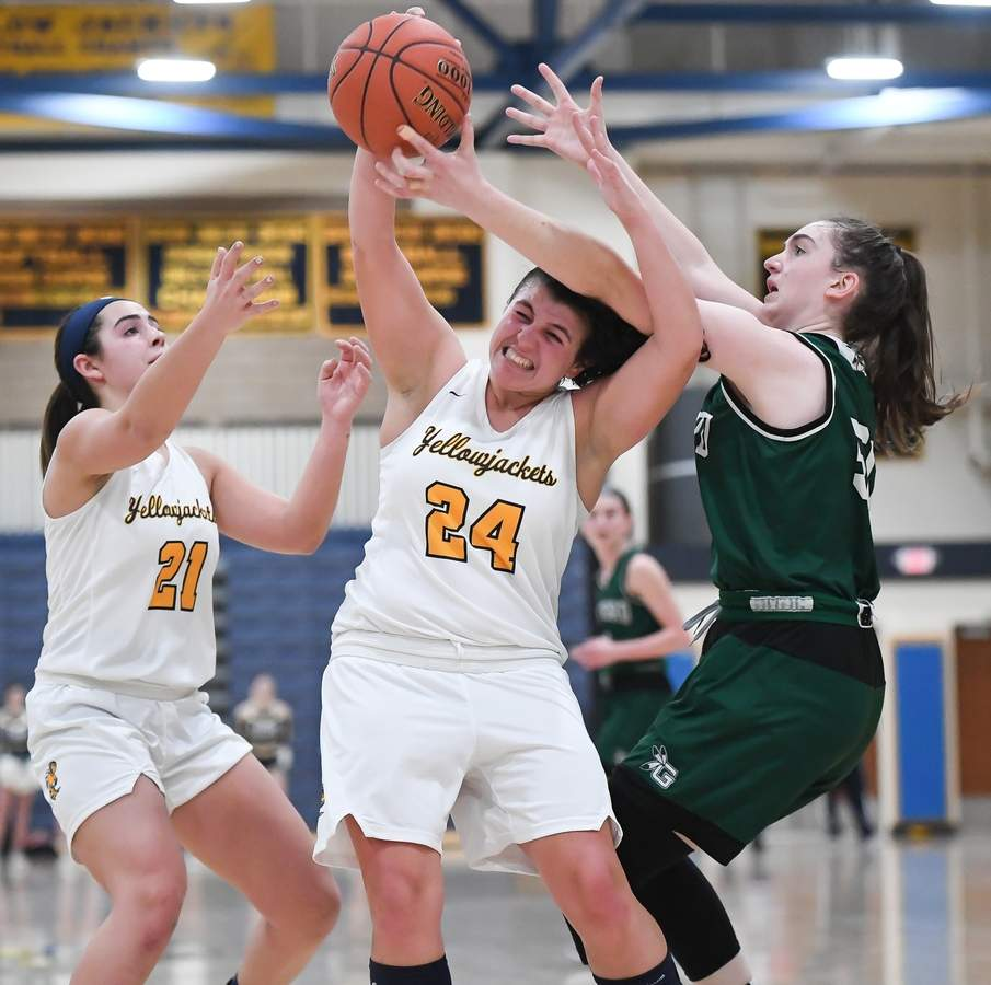 East Haven girls basketball beat Guilford 39-29 in the first round of the SCC Championship Tournament. Isabella Ragaini (21), Alexis Pendziwater (24) Photo by Kelley Fryer/The Courier