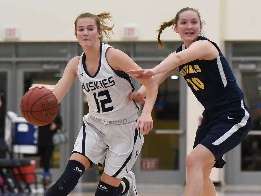 Junior captain Catie Donadio and the Morgan girls' basketball team played to an impressive record of 18-5 this season. Donadio earned the Huskies' Most Valuable Player Award after leading them in points (15.8), assists (4.8), and steals (4.9) per games. Photo by Kelley Fryer/Harbor News