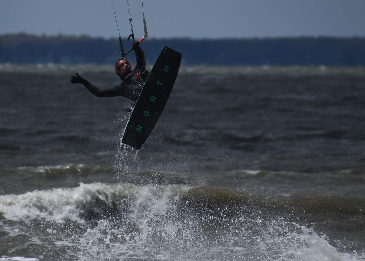 The wind was blowing from the West and whipping up the surf at Hammonasset Beach State Park Saturday afternoon and the kiteboarder were there to take advantage of the steady wind and surf. Marcus Garofalo takes to the air.     Photo by Kelley Fryer/The Source