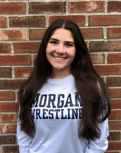 Senior Sage Follo lent a helping hand as a manager for the Morgan wrestling team the past four years. Sage is also a captain on the Huskies' softball squad.  Photo courtesy of Sage Follo