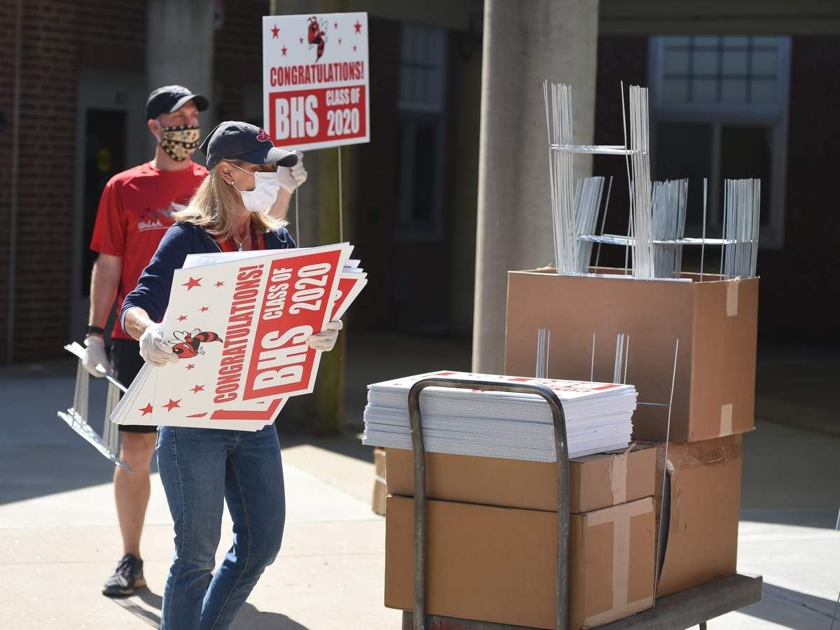 Branford High School Class of 2020 got a special delivery on Wednesday, when around 40 teachers, staff and members of the administration organized, and distributed 264 commemorative 2020 graduation signs to the students homes. Dean of Students Dianne Dadio gathered a stack of signs with BHS  Class of 2020 co-advisor Chris Stonier. Photo by Kelley Fryer/The Sound