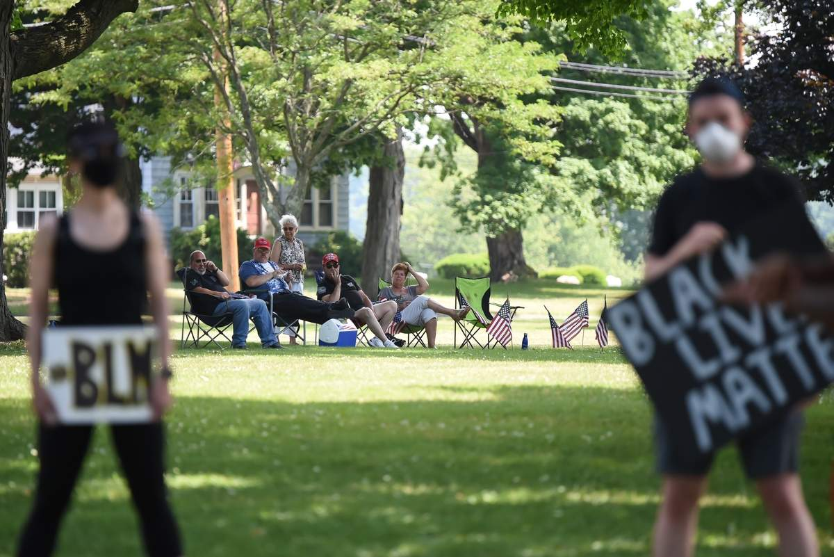 A small Black Lives Matter demonstraton took place on the East Haven Green with a separate group of friends who gathered also on the Green to see who would show up. Pete Cianelli and friends keep an eye on things from a distance.  Photo by Kelley Fryer/The Courier