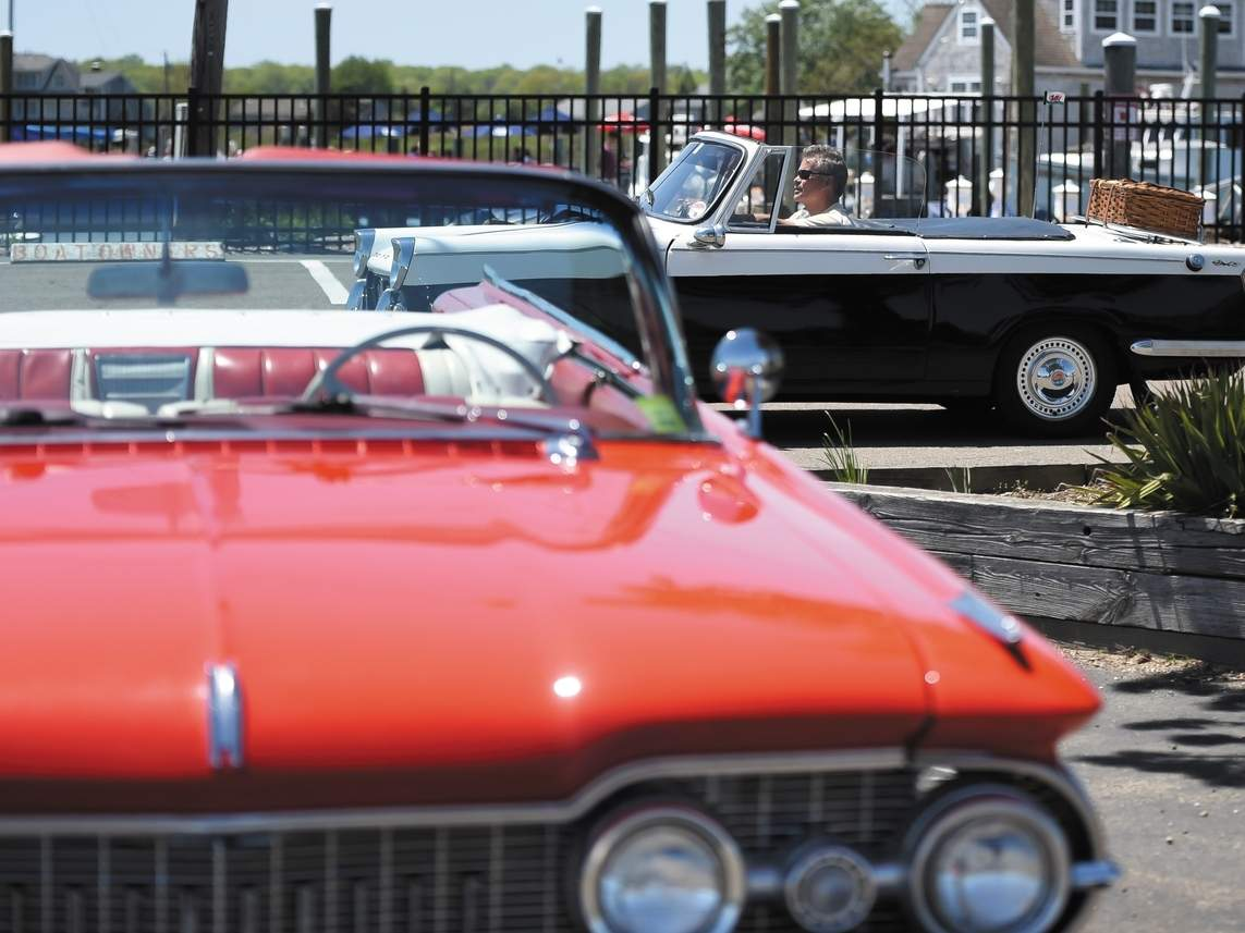 Sunday afternoon at Guilford Point was a buzz with a car show, boaters, people fishing and grabbing a bite to eat.   Photo by Kelley Fryer/The Courier