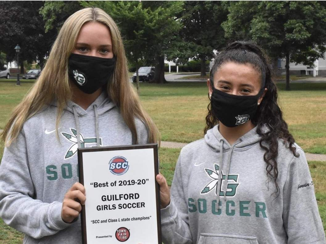 The Southern Connecticut Conference recently presented the Guilford girls' soccer squad with an honor in recognition of the team's achievements from the 2019 season. Pictured with the award are Madison Gambardella and Gabi Garcia-Perez, who were the team's senior captains throughout the season. Photo courtesy of Kim Gambardella