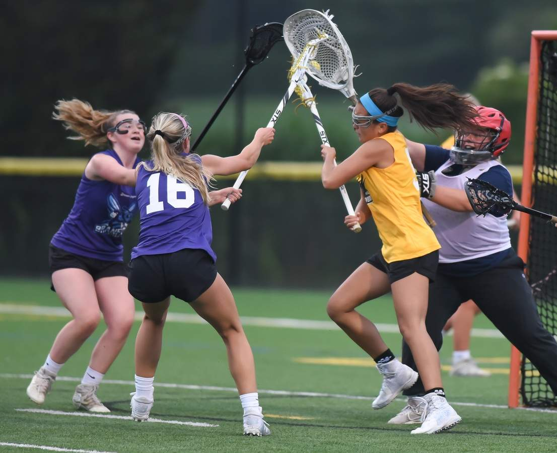 The Branford Sting lost 8-16 to the Madison Mavericks in the Dream League Girls Lacrosse game held at the Madison Surf Club Tuesday night.  Isla Lionetti (16) Photo by Kelley Fryer/The Sound